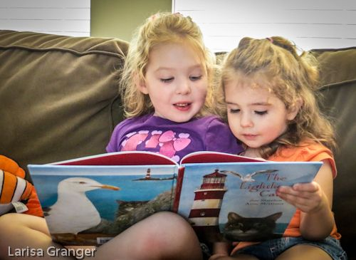 Kate and Emmy reading Lighthouse Cat