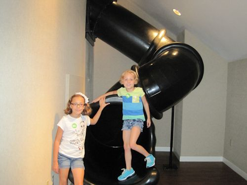 There are several slides throughout the Magic House. The girls went on each one several times.