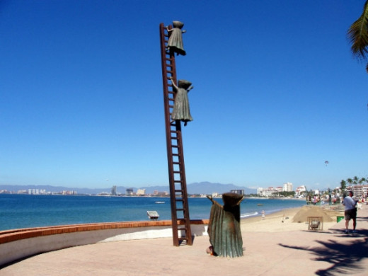 This is a sculpture along the beach.  it portrays children climbing a ladder to heaven.