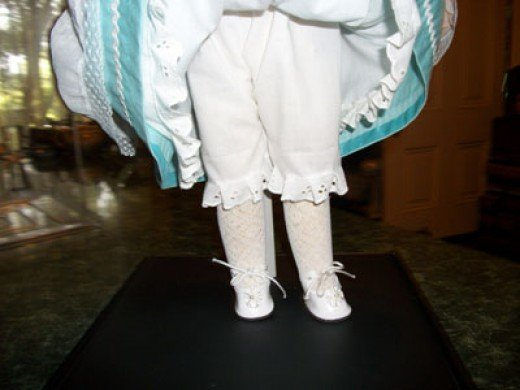 Petticoat, pantaloons, white stockings and shoes.