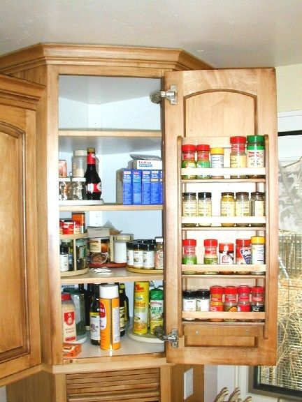 Nicely organized spice cabinet above an appliance garage