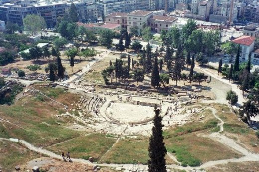 And on the opposite side of the Acropolis, if you look waaaaay down over the wall... it's the Theater of Dionysos, where all the famous plays of ancient Greece were staged!