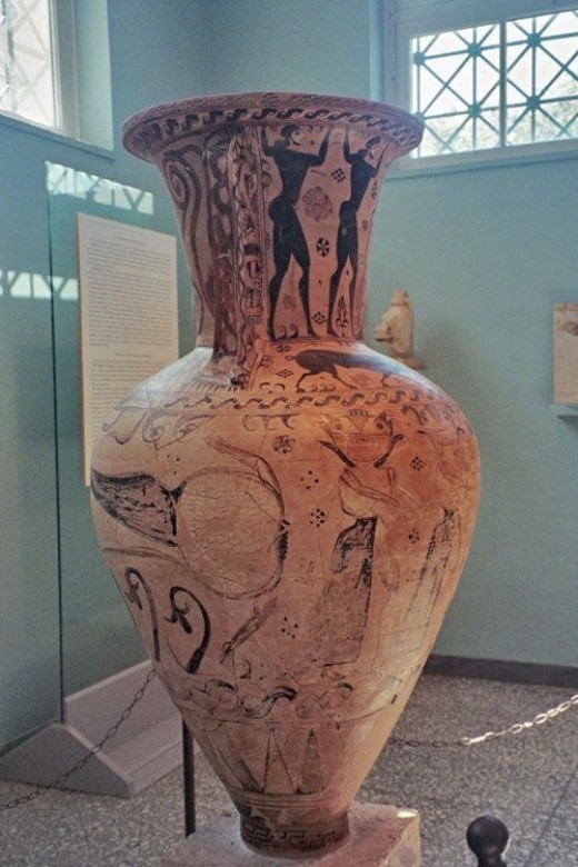 The side view of the Eleusis Amphora shows the decapitated body of Medusa -- which explains why her sisters are chasing Perseus as he runs away with the Gorgon's head. Notice the door in the background: this vase is huge. (I don't have