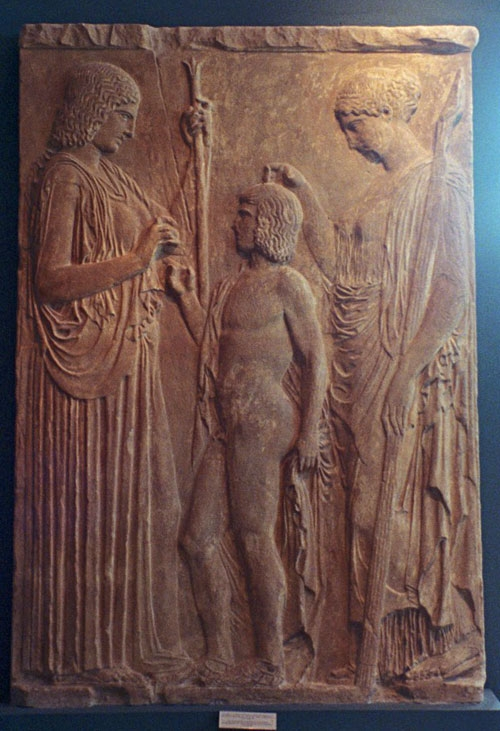 A plaster cast of the Great Eleusis Relief; my photo of the original is in my section on the Museums of Athens. 5th century BCE. Demeter at left offers grain to Triptolemos, while Persephone, holding a torch, blesses him.