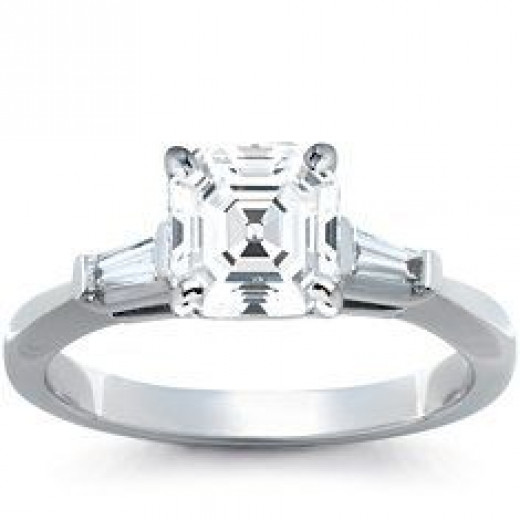 A three stone tapered baguette platinum setting with 2.0ct asscher center stone