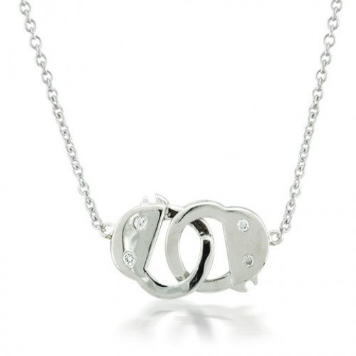 Looking for a delicate handcuff necklace with a little sparkle? Try this silver necklace with CZ accents.