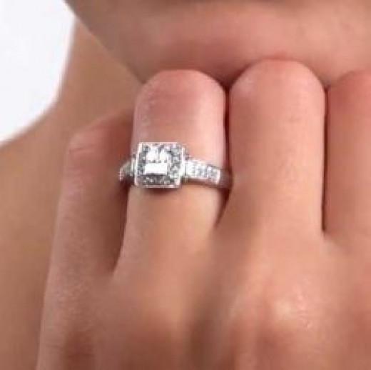 Quad Engagement Ring on Finger
