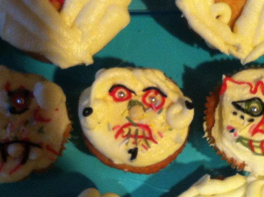I made up these scary face cakes, but they were based on the designs of the Day of the Dead sugar skulls in the book