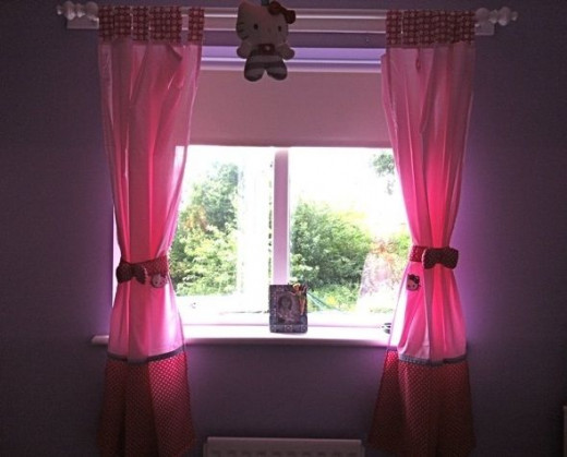 Hello Kitty curtains and uplighter in my daughter's room