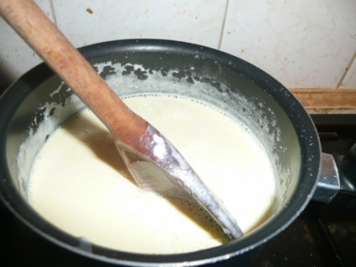 6. Pour it all back into the pan and warm over a very low heat, stirring continuously