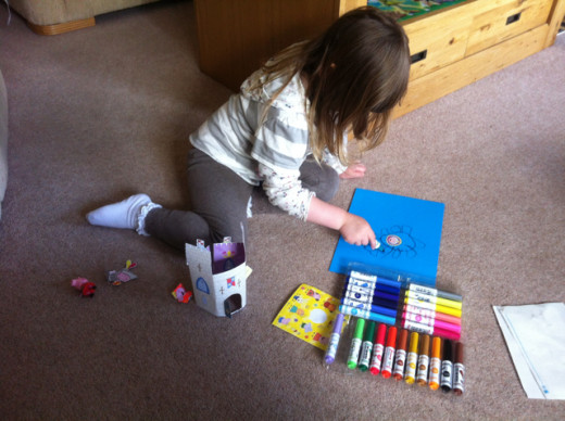 At 3, a love of paper crafts continued (along with the drawing)...