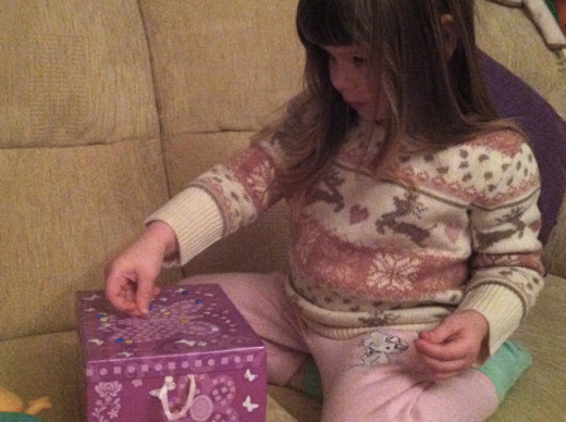 ... and decorating her own items like this sparkle jewelry box kit