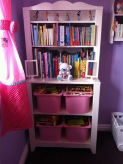 My daughter's dresser from Ikea, housing both books and tubs of toys