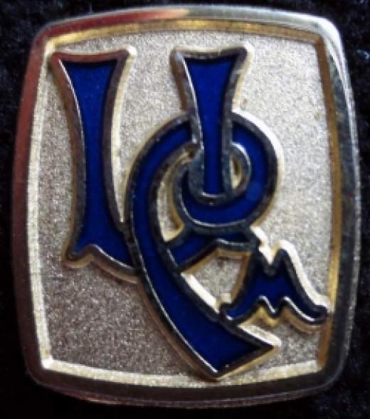University Club Logo blue enamel on gold pin