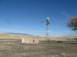 A windmill draws water from ground for ranch land across from the Fray Marcos de Niza monument in southern Arizona.