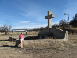 My wife posing in front of the monument to Fray Marcos de Niza in the Coronado National Forest in southern Arizona.