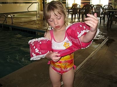 Putting floaties on and getting ready to swim!