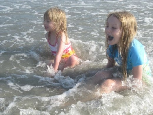 This was my smallest girls' first time in the ocean! They were so excited! Here they are bracing for a wave to hit them.