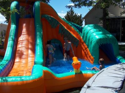 Summer 2008 begins with a big splash at our house with our brand new water slide! Let the fun begin!!!