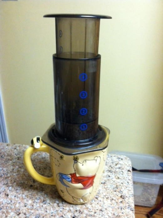 This is the last stage where you push in the plunger part and force all the water into the mug. Very easy to push, btw!