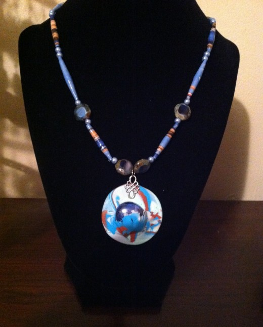 Polymer Clay and hand-rolled paper beads.