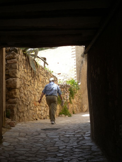 Gary walking up the drawbridge of the Templar Castle.  Still in use by people driving their cars to get to their homes.