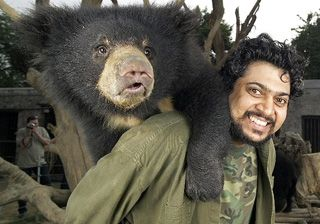 Kartick with a rescued cub on his back