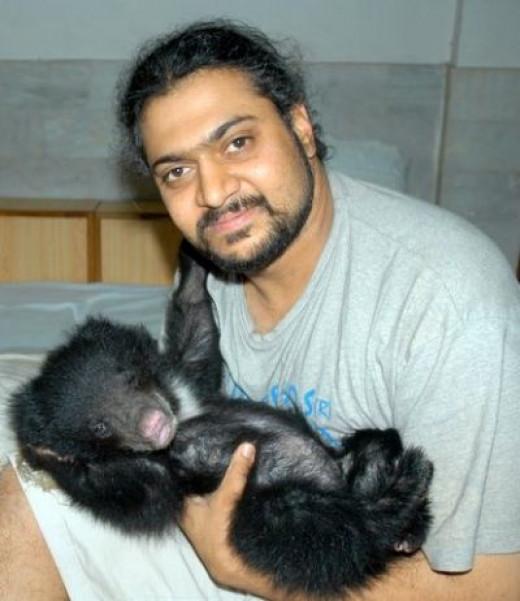 Kartick cradles rescued cub