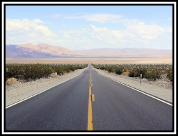 The wide open road in the desert north of the Joshua Tree National Park, heading towards Death Valley. Photo by me under Creative Commons 2.0