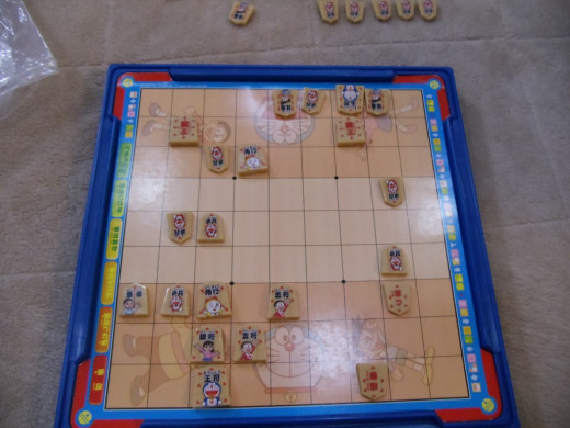 The end-game board when my host sister and I played Shogi. I won. ;) It's a children's board (with the funny characters), but she was a MASTER.