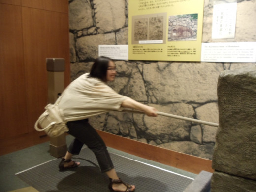 My host sister in Nagoya pulling a rope to get a museum display to move!