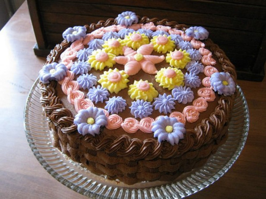 This was the first cake I decorated with my new kit. It took 8 different tips to make the basket weave sides, the rope edges and the various flowers.