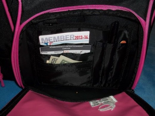 The front pocket holds my member card, bowling fees and a file to fix the thumbnail that breaks every other game.