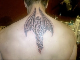 Two Faced 'demon' tattoo