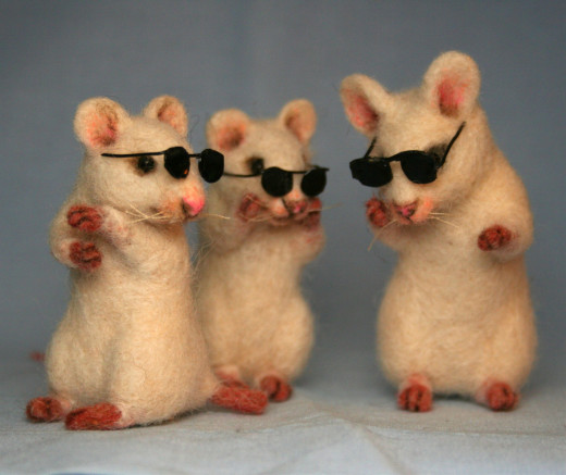 "This little trio was insppired by an old childhood song titled, ""Three Blind Mice.""  Each mouse was needle felted around a wire armeture to allow for the mice to hold a pose."