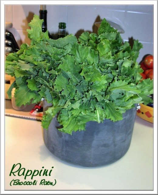 Rapini is a wonderful side dish.  Rapini  (broccoli rabe) is a staple of Naples, and a very simple dish to make.  It is also one that takes a little time to prepare, and in order to cook a lot, you need to be prepared.  This giant pot of greens actua