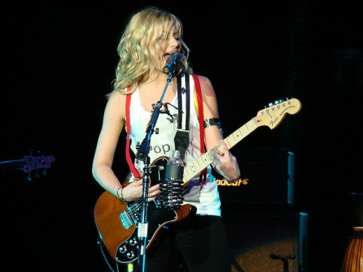 Alyson Michalka (of Aly and AJ) singing and playing the guitar.