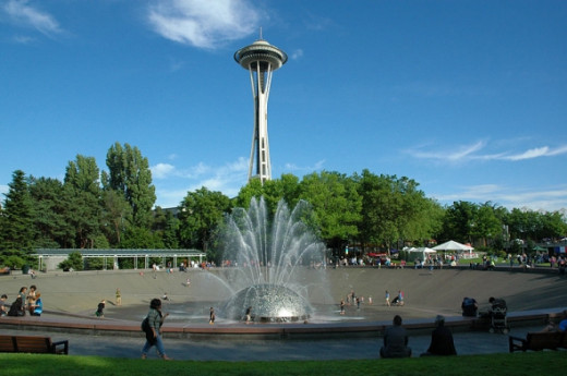 Seattle Center is the home to the Space Needle and the International Fountain (foreground). The center and the attractions were built as part of the 1962 World's Fair hosted in Seattle.