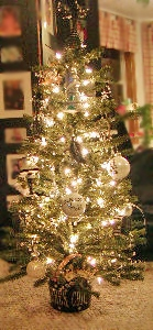"""The tree came with white lights but I added an additional 50 light strand in honor of the """"City of Lights"""". I decided to use a black, white, gold and silver color scheme for this tree. In the wedding department at my local superstore, I found some wi"""