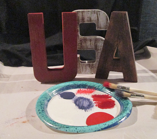 "The ""A"" was done in navy blue. Here are all three with their first coat. It dries really fast since you aren't using much paint. I re-coated the ""U"" right after I finished the 1st coat on the ""A""."