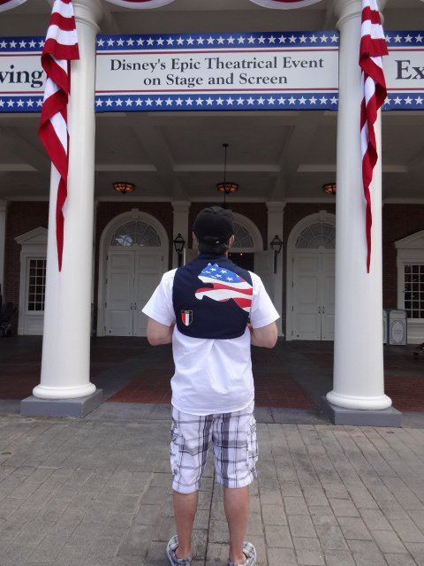 Ricky Toting His Newly Purchased Patriotic Backpack in Front of the American Adventure