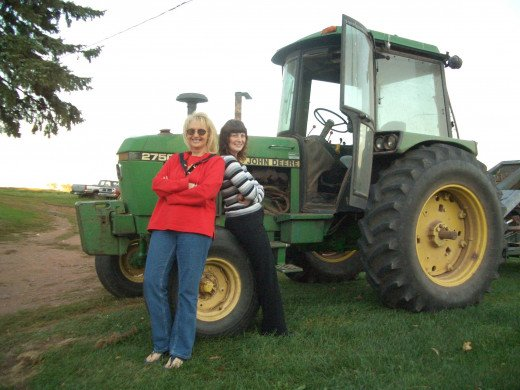 Me and my little Sister with Dad's John Deere