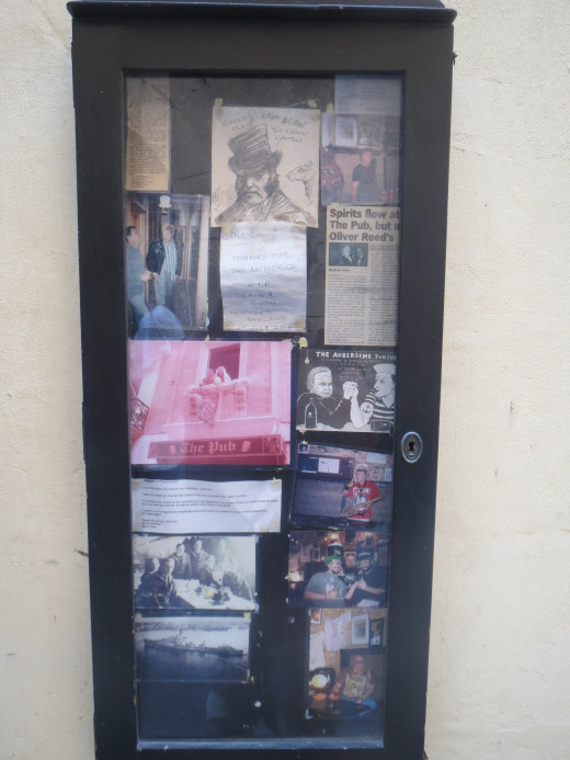 Newspaper cuttings etc about Oliver Reed outside The Pub in Valetta