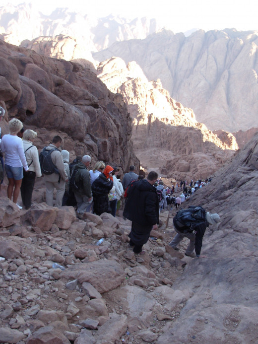 At sunrise people going down the Sinai Mountain back to the foot whre is St. Catherine's Monastery