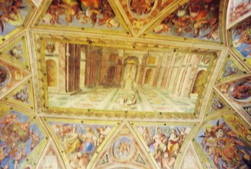 Part of the ceiling inside the Sistine Chapel, a very long, narrow room with tall ceilings.