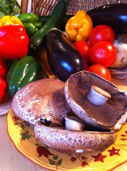 Basket full of veggies off the garden, and portobella mushrooms from the market.