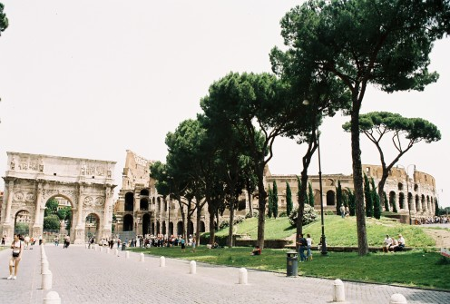 The Arch of Constantine on the left and the Colosseum on the right. The arch was erected in 315 A.D. to commemorate the triumph of Constantine I after his victory over Maxentius in the battle at the Milvian Bridge in 312 A.D.