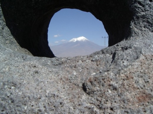 Close view of a hole of an Anchorstone looking at Mount Ararat