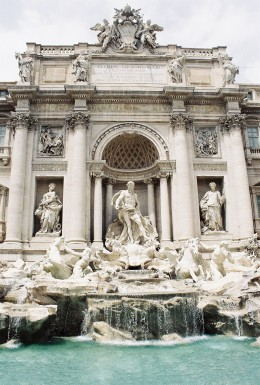 "The Trevi Fountain, completed in 1762. It is now an icon, having been featured in such movies as ""Three Coins in the Fountain,"" ""La Dolce Vita,"" and ""Roman Holiday."" A legend holds that if visitors throw a coin into it, they will return to Rome."
