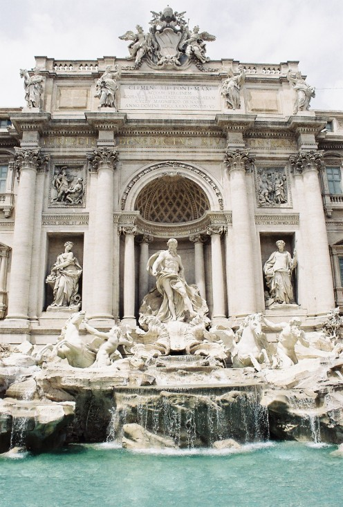 """The Trevi Fountain, completed in 1762. It is now an icon, having been featured in such movies as """"Three Coins in the Fountain,"""" """"La Dolce Vita,"""" and """"Roman Holiday."""" A legend holds that if visitors throw a coin into it, they will return to Rome."""
